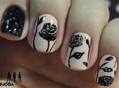 Paint silhouette fall flowers on your nails using a black polish for details and white as base color