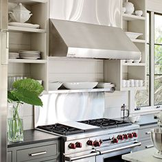 our stove looks just like this...i should suggest open shelves to my husband...the kitchen it totally his space though...i avoid it ...by request of the children...i can't cook!