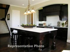 Would love a big center island in my dream kitchen:)  love the island and the mantle over the stove.  would prefer white cabinets and darker backsplash and countertops..but would take this anyday!:)