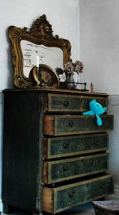 antique dresser in dark jade