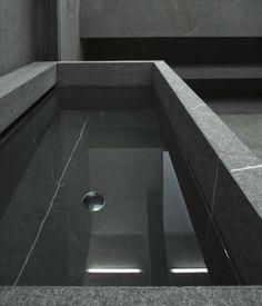Stone bath by Jon W Benedict, made by Belgian stone company Van Den Weghe.