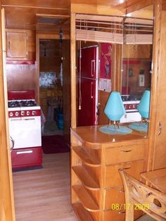 Interior of a '51 Spartanette Tandem. Look at the little curved shelves! And the red and white stove and red fridge!