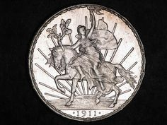 """Mexico Caballito One Peso Silver Coin of 1911. Shortly after the Mexican Revolution, the newly formed Mexican Government issued their first Peso coin referred to as the """"Caballito Peso"""" meaning Small Horse Peso. The Cabillito Peso was a crown size coin struck in 90.3% silver to celebrate the War of Independence and was issued from 1910 to 1914."""