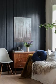 A sitting room with a black wall in a cosy Norwegian home in the country