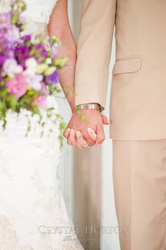 wedding photo, spring wedding, wedding kiss, wedding hair, hair piece, jewel hair piece, jewels and pearls, wedding dress with sleeves, white dress, cream tux, purple tie, blue tie,