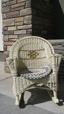 Vintage wicker rocking chair in great condition. This rocking chair is sturdy enough for a child or would be a great show case item for a doll.