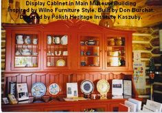 Display Cabinet in Main Museum Building Inspired by Wilno Furniture Style. Built by Don Burchat. Donated by Polish Heritage Institute Kaszuby.