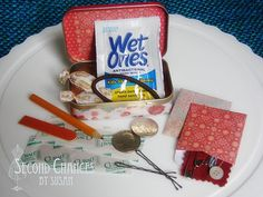 purse kits; I did these for all of the important women in my life for Christmas this year. Instead of an Altoids box I used a tin gift card holder from Michale's. I also added tweezers and safety pins.