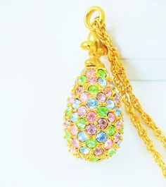 This is a gorgeous gold tone #necklace by  Joan Rivers.  The pendant is gold tone with tons of beautiful #pastel color crystals and is shaped like an egg. The pendant is 1-1/... #black #egg #signed #vintage #jewelry #crystal #pink