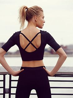 Ballerina Crop Top | Designed with Free-Flow fabric technology to properly ventilate and wick sweat during your toughest workouts, this feminine performance top features a cropped silhouette, half sleeves, and scoop back with crisscross elastic straps. Front lined for a seamless look. *By FP Movement + Onzie