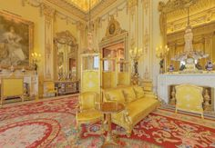 The White Room, Buckingham Palace.  the White Drawing Room of Buckingham Palace.  The word 'opulence' comes to mind here.  Large gilded mirrors, yellow silk, massive crystal chandeliers.  Notice the doorway and the detail of the trim.  Beautiful!