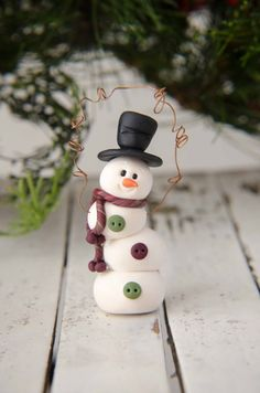 *POLYMER CLAY ~ Topsy-Turvy Clay Snowman Ornament by Creative Contours. $10.00, via Etsy.