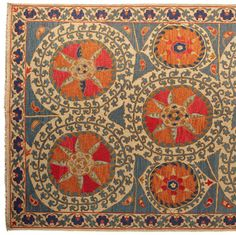 This vibrant rug marries the Suzani embroidery tradition of Uzbekistan folk art textiles with the sturdy soumak style carpet of New Zealand wool with a cotton warp and weft, to create a rich, dimensional texture. Handcrafted in Nepal. Vermilion medallions illuminate the ground of biscuit and gray-blue. Available in sizes 3' x 10', 4' x 6', 6' x 9', and 8' x 10'. Additional shipping, $20.