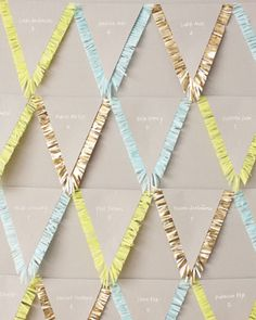 Fringe Pennants as escort cards...would make a fun backdrop, or create a garland (Martha Stewart Weddings)