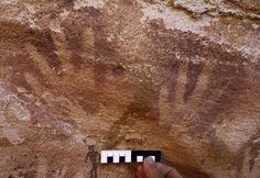 """In the Egyptian portion of the Libyan Desert, there's a cave called""""The Cave of Beasts"""" thatcontains over 5,000 cave paintings. Also known as Wadi Sura II, the cave was only discovered in 2002 by amateur explorers. Among the depictionsof animals and dancing humans, there's a curious portion of wall covered in hundreds of handprints. The cave art was created at least 7,000 years ago, using the technique ofplacing a hand on the wall and then blowing paint on top, like a stone-age spray…"""