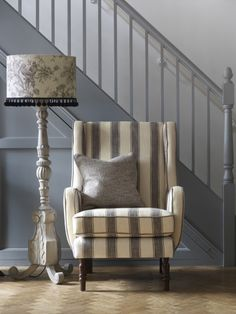 Very Elegant - Clarke and Clarke - Fairmont Fabric Collection - Armchair with wide cream and grey stripes, plain grey scatter cushion, floor lamp with a large grey carved stand and a floral, fringed shade How To Make Curtains, Made To Measure Curtains, Cottage Wallpaper, Clarke And Clarke Fabric, How To Hang Wallpaper, Fabric Wallpaper, Fabric Houses, Dream Home Design, Rug Sale