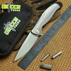 Green thorn F7 Flipper folding knife ball bearing M390 blade Titanium handle Small pattern outdoor camp tactical knives EDC tool(China (Mainland))