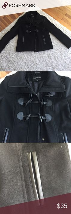 Express Wool Toggle Front Coat Selling a black Express toggle front and zippered wool coat. Oversized, super trendy wide collar.  Size medium. Hits at the hip. Outside material is 82% wool and 18% polyester. Faux leather lining along side pockets on front of coat. Very warm. Sheer leopard design on inside of coat. Smoke free home! Make an offer! 🎉🎉 Express Jackets & Coats Pea Coats