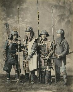 Samurai with bow and arrow, helmets, swords, spears and coats of mail. Photo from series of 42 hand coloured albumine prints at Spaarnestad Photo by Felice Beato, Kusakabe Kimbei or Raimund baron von Stillfried. Japan, around 1880.