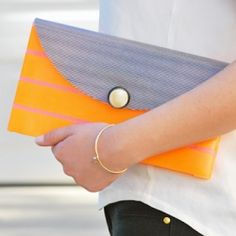 Use colorful washi tape to turn a plastic envelope into a stylish clutch. So easy! (full tutorial)