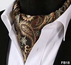 We love the arrangement of beige and brown colors of this 100% silk and self knotting ascot Tie! The small touches of white highlight its overall classy style.