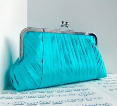 Silk turquoise blue pleated clutch in frame with chain by toriska, $60 (available in other colors)