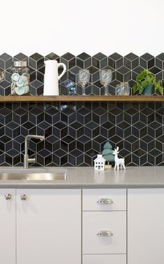 Satin and glossy tile mixed together for modern and minimal kitchen backsplash.