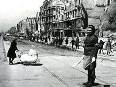 Noted Red Army photographer Yevgeny Khaldei captured this photo of a typical Berlin intersection in May A female Soviet soldier is controlling traffic as a German mother crosses the street. Berlin 1945, Germany Berlin, Berlin Photos, Total War, Red Army, Women In History, World War Two, Cool Photos, Amazing Photos