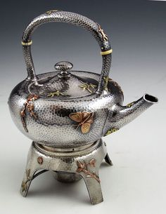 Dominick and Haff sterling and mixed metals hammered teakettle on stand c1880 (Britannia Silver)