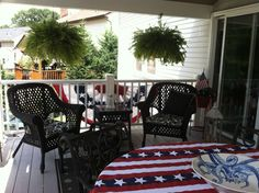 Covered porch dressed for the 4th with nautical accents