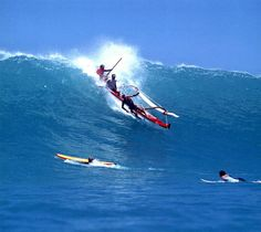 Riding a wave half way out of the outrigger to steer it straight!