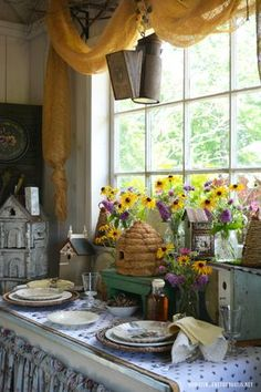 The Bees Knees Table and bee skep with Black-eyed Susans in Potting Shed | homeiswheretheboatis.net