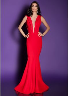 Evening dress crafted in lace, crepe and fine mesh Mermaid evening gown with open back V-neckline with lace appliques and built-in bra cups Color of the dress: red Dress closes to the back with zipper Short train