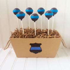 Police themed cake pops. Made by Painted and Sprinkled.