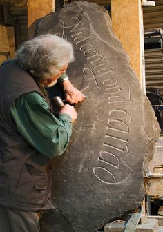 Frankly, I can't imagine how he does this.  Lovely curves carved into rock.  Amazing. lettering by Ieuan Rees:  http://www.ieuanreeslettering.co.uk