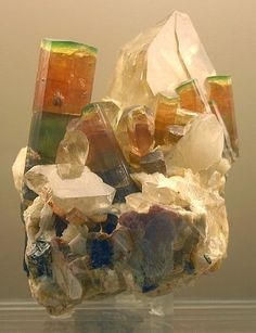 Hey! This is at the natural history museum in L.A.. Hands down, the third best gem and mineral collection in America - -  elbaite on quartz, Himalaya Mine, San Diego, California