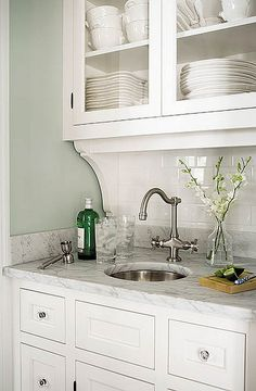 Love everything about this: butler's pantry with marble, under-mount round sink, corbels, and of course white cabinetry.
