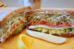 """DEL MONTE SPECIAL: Plenty of fresh Avocado and Monterey Jack Cheese on 9-Grain Wheat Bread with Erik's """"Secret Goo"""", Red Onions, Tomatoes and Sprouts"""
