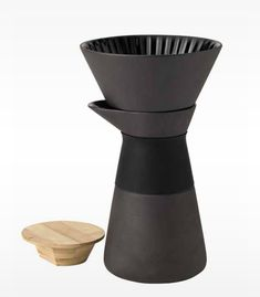 """The award-winning Theo range has  launched a coffee maker for all """"slow brew"""" filter coffee fans. With its beautiful contrasts, the Theo range has been designed to stimulate the senses. Made in matt black stoneware with a shiny glaze the Theo coffee maker is both rustic and elegant. The filter funnel only has three holes at the bottom, so the run-through time is naturally reduced. Enjoy a delicious, aromatic coffee every time with the Theo coffee maker. The Theo coffee maker holds 0.6 L…"""