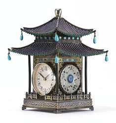 A CHINESE EXPORT SILVER, ENAMEL AND JADE PAGODA-FORM TABLE CLOCK<br><P>1st half 20th century</P> | Lot | Sotheby's