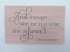 """Pink wooden sign with quote, """"And though she be but little she is fierce"""". Pink wash with gray lettering. Great sign for the nursery!"""