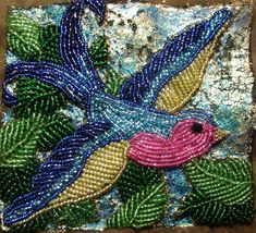 My beaded bluebird of happiness.  Seed beads and gold leaf on faux suede.
