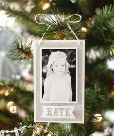 If your pictures are piling up in cardboard boxes, use these crafts as an excuse to finally get organized and trim the tree.