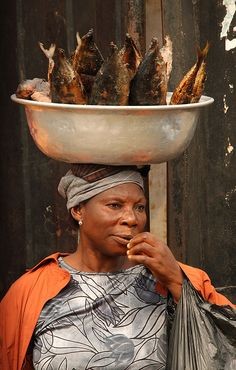 Woman selling smoked fish by Raphael Bick on Flickr