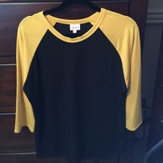 LulaRoe Randy Black|Yellow XL NWT! LulaRoe Randy Black|Yellow XL NWT! So cute & SUPER COMFY! Three-quarter length Raglan sleeve in yellow! LuLaRoe Tops Tees - Short Sleeve