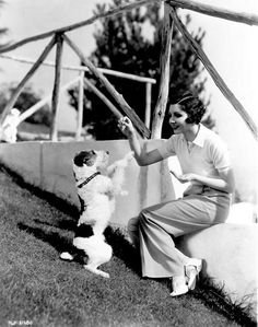 Claudette Colbert with a wire hair fox terrier.