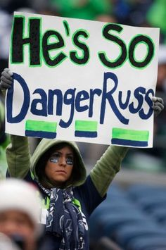 A Seattle Seahawks fan holds up a sign for quarterback Russell Wilson before an NFL football game between the Seattle Seahawks and the Arizona Cardinals in Seattle, Sunday, Dec. 9, 2012. Photo: AP / SL