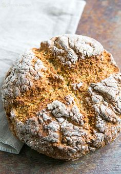 Oatmeal soda bread! A quick bread made with finely ground rolled oats, flour, buttermilk, egg, and baking soda. Perfect for St Patrick's Day! On SimplyRecipes.com