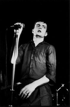 Ian Curtis perfoming on stage at The Factory/Russell Club, Manchester, 13th July 1979.