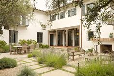 """I like how this patio is divided into """"rooms"""" with the grasses (maybe sedge?)  Twitter / houzz: Tell us: Are you a fan of Mediterranean design?"""